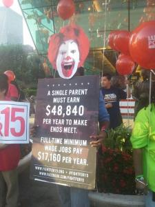 A protester in Chicago held up this sign outside a McDonald's on August 29, 2013. Fast food workers in 60 U.S. cities went on strike that day calling on the industry to raise worker pay.